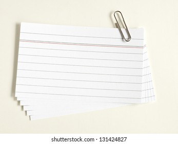 note cards with clip on yellow background