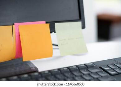 note list paper on computer monitor.sticky note reminder paper for task and message.Office objects equipment.