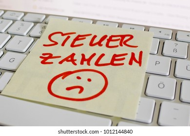 note on computer in german keyboard: pay tax
