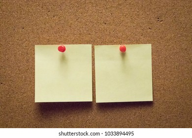 note on cork board post it note thumbtack