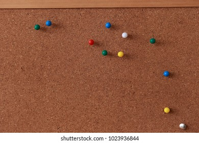 Note on a pin board - isolated on brown background