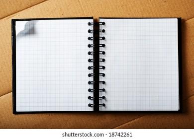 Note pad on cardboard.