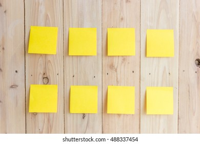 The note pad on the wooden wall.
