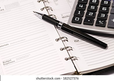 note pad with pen and calculator