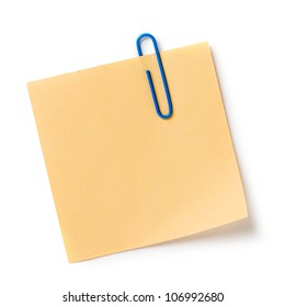 Note with a paper clip. Isolated on a white background with a shadow