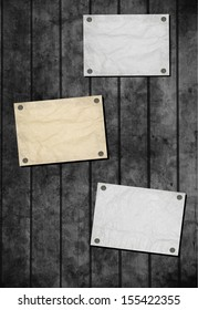 Note paper and paper clip on wooden background