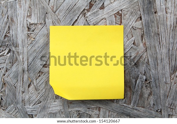 Note paper stick on wood background
