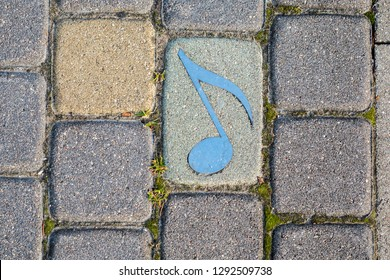 Note in the paving slab. Musical Note in the paving tile. Music in the paving slab.