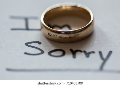 """The note says, """"I'm sorry"""". Leaves wedding ring with the note."""