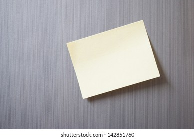 note slip stuck on fridge background