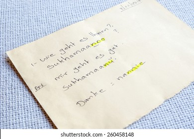 """note with translation-phrases from German to Malayalam meaning """"How are you"""", """"I am fine"""" and """"Thank you""""."""