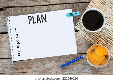 Notebook with an action plan and sticker today on wooden desk with cup of coffee and muffin