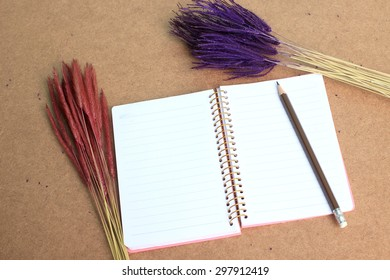 notebook and a bouquet flowers