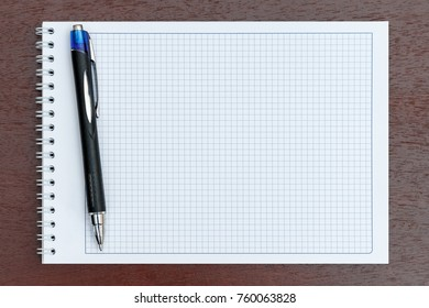 The notebook in the box with pen closeup
