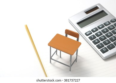 Notebook, calculator,  and miniature desk  / Study or student insurance image
