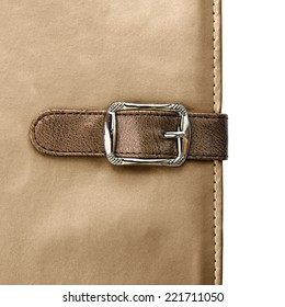 notebook closeup with buckle in the form of a leather strap