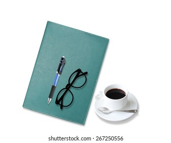 notebook with  coffee cup with pen and glasses on white background
