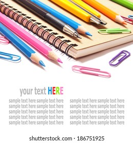 notebook and color pencils stationery isolated on white background