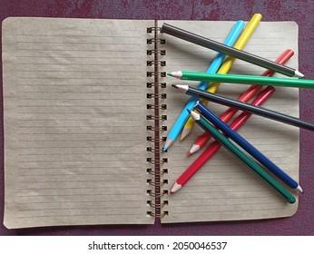 notebook and the colourfull pencils
