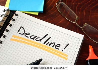 Notebook with Deadline  sign on a table. Business concept.