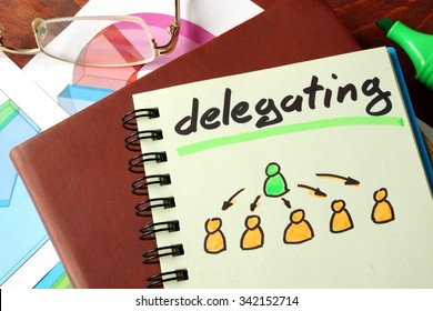 Notebook with  delegating sign.  Business concept.