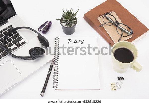 notebook with to do list on white desk office from above, planning and reminder concept.
