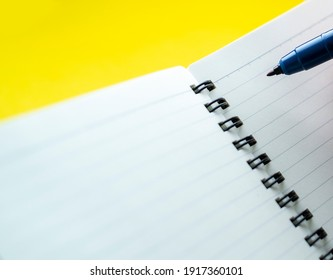 Notebook empty page and pencel for background and design