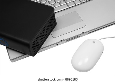 notebook and an external hard drive on a white background