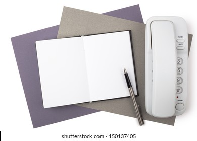 A notebook, a fountain pen, and a white phone on sheets of textured colored paper isolated on white background.