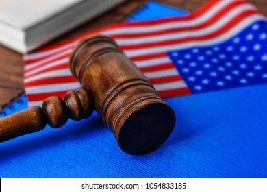 Notebook, gavel and American flag on table. Legal immigration