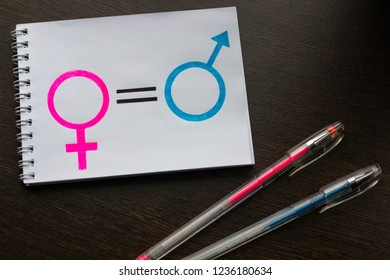 notebook with gender equality women and men symbols