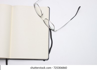 Notebook with glasses