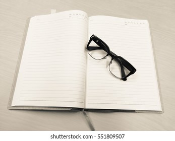 notebook and glasses readly to meeting