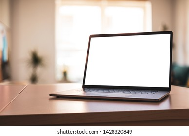 Notebook Laptop with blank screen on table in living room - angled position