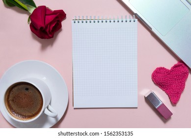 notebook, laptop, coffee Cup, red rose flower, lipstick, heart on beige background