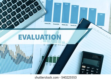 Notebook and Laptop with graph and charts. Business Concept with word Evaluation