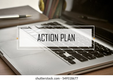 Notebook and Laptop with text ACTION PLAN
