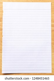 Notebook Lined Paper on wood Background