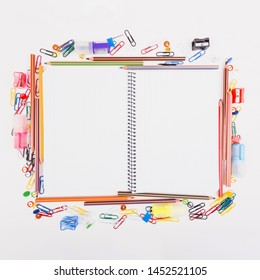 Notebook lying with school stationery