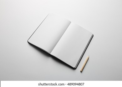 Notebook Mock-up with elastic band closure,redy to replace your design.