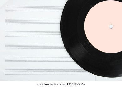 Notebook for musical notes and and vinyl record. Concept music.