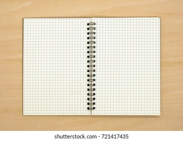 notebook on brown background top view copy space
