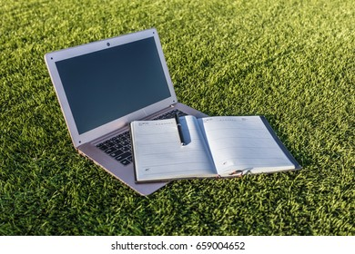 Notebook on the campus of the grass