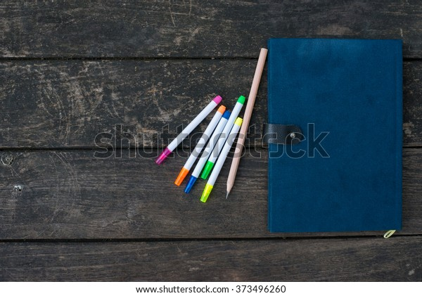 Notebook on desk and Pencil