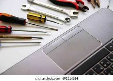 notebook on a desk with tools