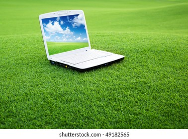 notebook on the green field of spring grass