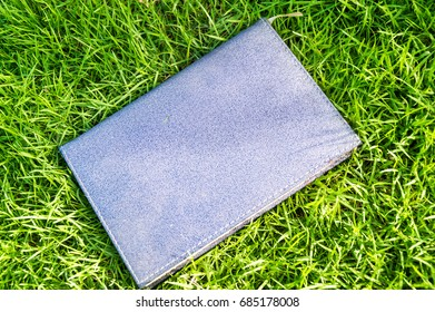 a notebook is on greensward.