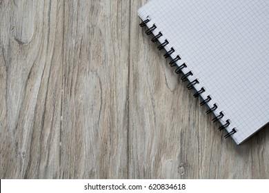 Notebook on ligt wooden background