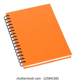 Notebook with orange color cover isolated on white.