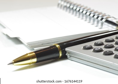 Notebook paper pen calculator finance